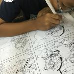bé học vẽ truyện tranh